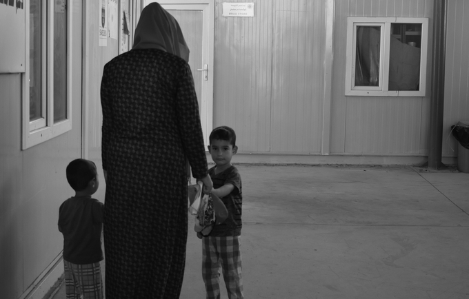 """""""All I could think of was that I was losing my child. At that moment, I felt the world just stopped. I only felt alive again when I held him in my arms"""" © 2018/UNFPA Iraq"""