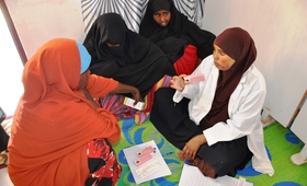 A midwife talks to girls about birth spacing at a youth firendly centre supported by UNFPA